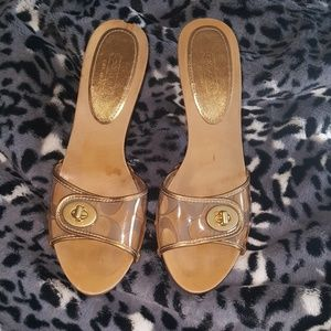 Coach 'Cagney' wooden mules. 'C' embossed slide.